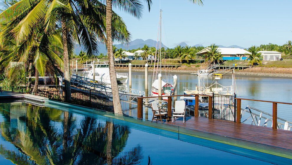 View over the water to Hinchinbrook Island mountains