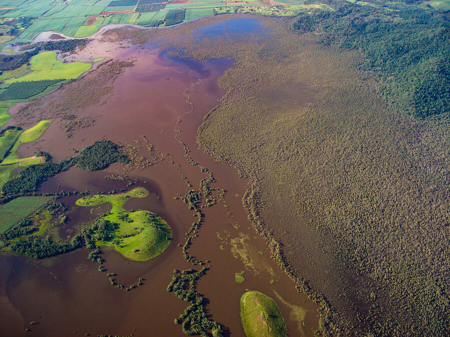 Eubenangee Swamp & red floodwater from volcanic soil