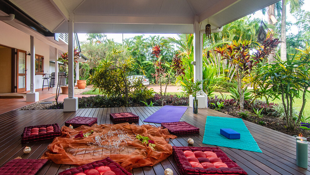 Patio set up with yoga mats & cushions