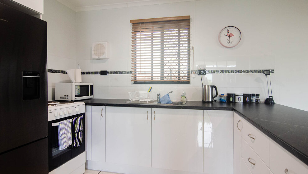 Galley kitchen with lots of bench space