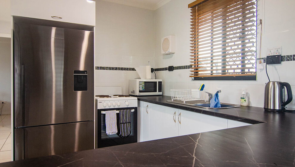 Large fridge, electric stove & oven