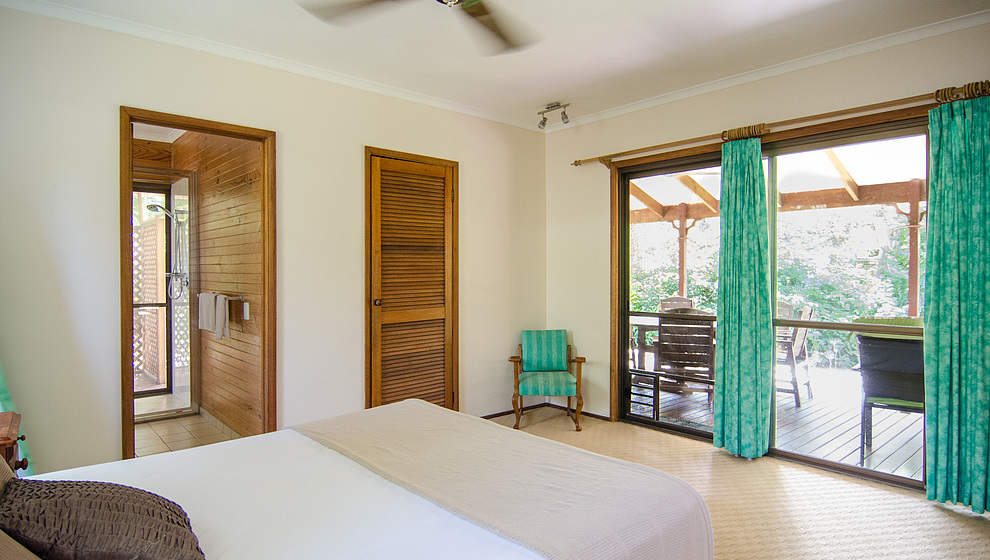 Bedroom 1 opens to the verandah