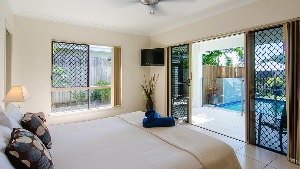 Eden queen bedroom 1 opens onto pool patio
